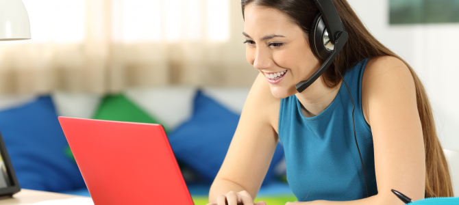 Woman laughing while taking an online course